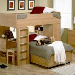 twin-loft-bed-with-desk-and-storage-drawers-use-ladder-with-two-beds-and-books-on-the-desk-with-wooden-stool