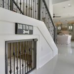 Under Stairs Dog Crate For Space Saving And Nice Interior Design With A Door That Matches The Railings And Combination Of Black And White Color