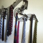 unique-and-decorative-wall-mounted-rack-with-musical-design-and-style-in-black-color-for-keeping-ties-unwrinkled
