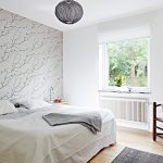 unique bedroom design with white color domination and wallpaper and glass window and arm chair and area rug and pendant lamp