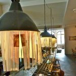 unique bohemian pendant light design in kitchen bar desig with glowing modern lighting