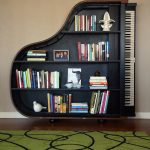 unique cool bookshelves design in black color with piano shape on wooden floor with green rug