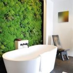 Unique Trend Bathroom Design With Luxurious And Modern White Bathtub And Climbing Plants On The Wall With Rustic Chair