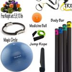 various home gym essentials consisting of free weight medicine and stability ball and jump rope