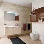 vintage bathroom design with black contemporary rug and floating wooden vanity and toilet and glass door and wall unit