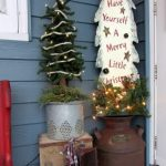 vintage-christmas-outdoor-decoration-with-old-milk-churn-farm-and-some-vintage-galvanized-items-like-bucket-and-watering-can -also-wooden-crates