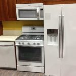 whirlpool-white-ice-collection-appliances-the-refrigerator-and-the-oven-and-the-dishwasher-and-the-microwave-in-a-kitchen