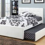 white and black Modern trundle beds with headboard plus brown rug and laminate floor plus gray painted wall