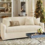 white interior design with white loveseat slipcover design with christmas tree and patterned white area rug and navy blue coffee table and storage