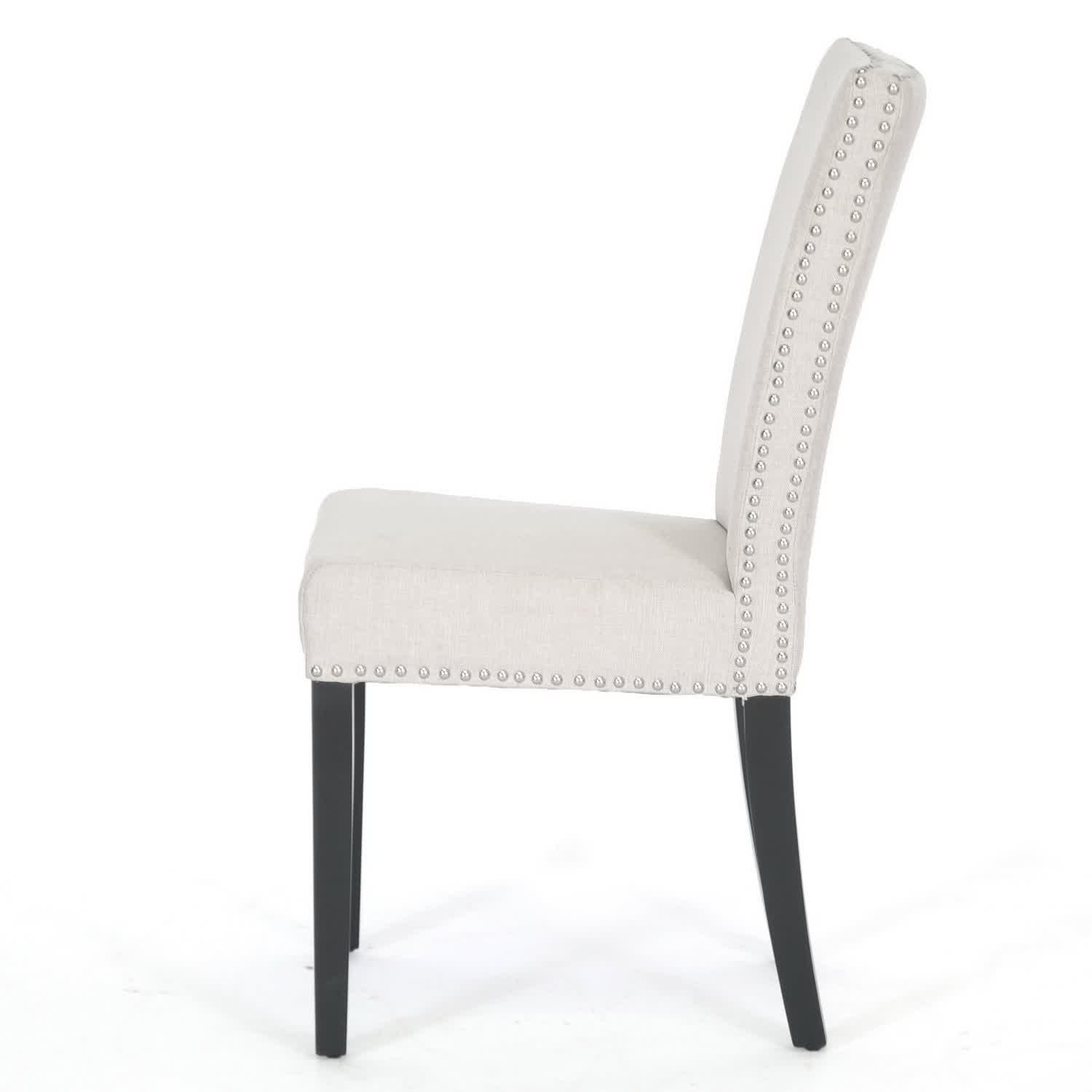 White Upholstered Dining Chair Covered With Leather And Embelished Nailheads For Comfy Area