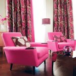 wondrous pink accent chair idea with brown patterned cushion and purple curtain and wooden floor