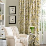 yellow patterned extra long curtain rods attached on glass door arranged in family room with white cozy armchairs with blanket and white cabinets and area rug