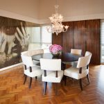 Amazing Wooden 8 Person Round Dining Table With Cool White Chairs Luxury Crystal Chandelier And Hardwood Floor