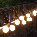 An arrangement of string lights for creating vintage look in outdoor area