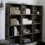 Arrangement of unused wine crates as bookcase idea