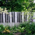 Black and white wood fences that looks like piano