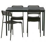 Black finished counter table with higher legs four chairs in similar finish scheme