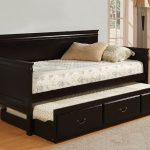 Black finished wood daybed with trundle and storage underneath