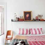 Black Shelf Above Bed Idea A Bed Frame With Colorful Bed Linen A Small Wood Chair
