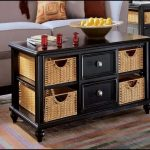 Black wooden coffee table with drawer system and baskets