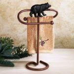 Brown finished metal hand towel stand with animal decoration idea