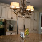 Classic Kitchen Makeovers On A Budget With Double Lights Of Chandelier Marble Kitchen Island And White Kitchen Cabinet Set