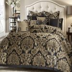 Classy black bed comforter with classic gold toned patterns