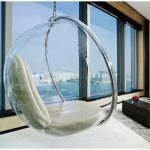 Cozy clear hang chair with white cushions