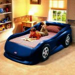 Dark Blue Of Race Car Beds For Toddlers With Wooden Side Table And Table Lamp Plus Rack