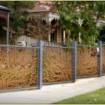 Decorative fencing idea with unique railing system and grey fence frames
