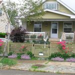 Decorative home fence system idea in shabby green