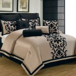 Gold and black bed comforter set idea with black classic motif