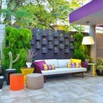 Grey concrete fencing idea with small wall mounted concrete planter boxes