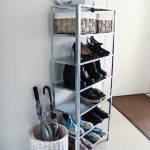 IKEA shoe rack idea made of lightweight metal a rattan basket for placing umbrellas