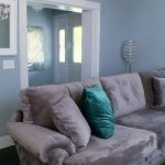 L Shaped Oversized Couches Living Room With Turquoise Pillows And Grey Room Wall