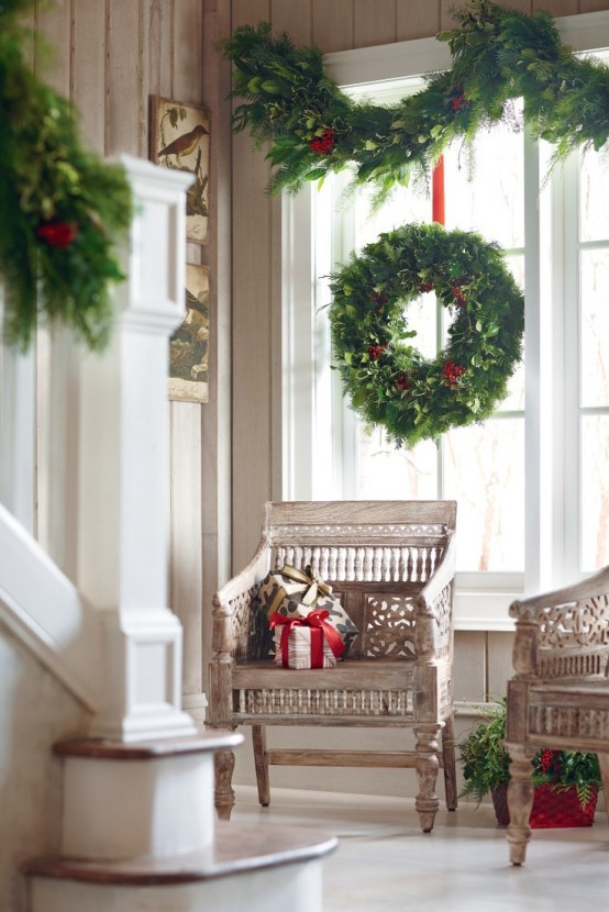 Gorgeous Christmas decoration idea for windows. Large green wreath for glass window