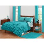 Layered turquoise bed comforter and turquoise pillowcases for simple wood bed frame with headboard medium sized turquoise bedroom rug simple wood bedside table with drawer