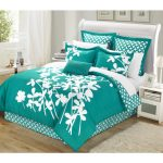 Luxurious turquoise bed comforter set with white flower pattern a Sleigh bed frame with white curved headboard
