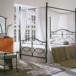 Metal Iron Canopy Bed Frame With White Bed And White Curtains Bench And Fur Rug