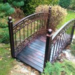 Metal garden bridge design with curved hand rails