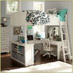Pretty white girls loft bed idea with U shaped desk bookshelf and ladder