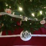 Rectangular Red And White Design Of Personalized Tree Skirts WIth Christmas Tree Lights