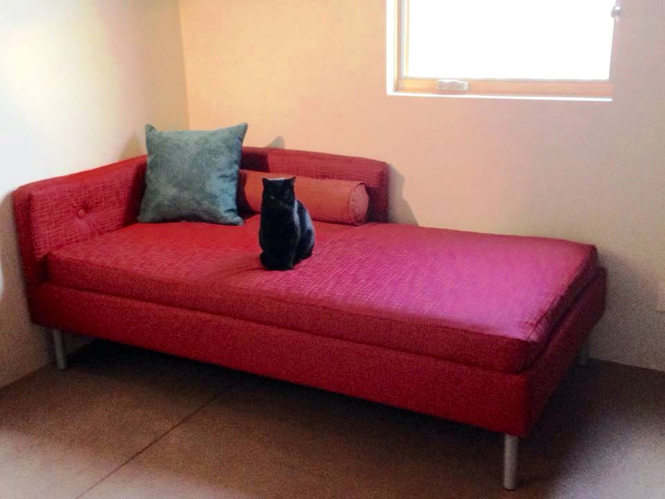 Red Extra Long Twin Daybed At Room Corner