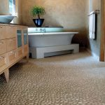 River Rock Tile Sheets For Bathroom Wall With White Tub Wooden Cabinet And Crystal Chandelier