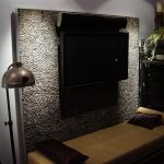 River Rock Tile Sheets For TV Wall With Long Bench Small Pillows And Floor Lamp