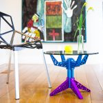 Round Clear Glass Coffee Table With Blue And Purple Metal Base