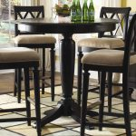 Round counter height table idea designed by IKEA four units of bar stools with cushions
