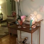 Simple Brown Bar Cart Accessories With Flower And Deer Head On Wall