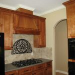 Simple Wood Vent Hood In Small Kitchen Space