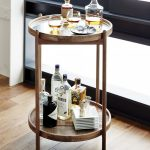 Simple round wood wine cart design with small casters